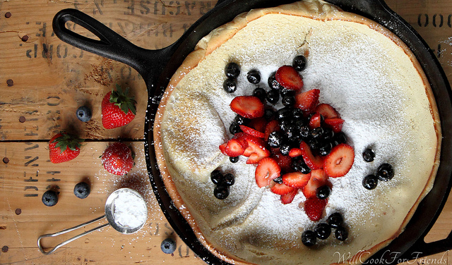 Dutch Baby (aka, German Pancake) with berries, lemon zest, and powdered sugar