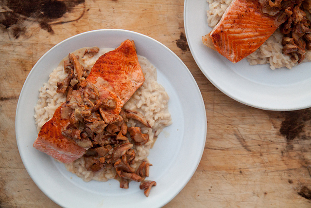 Pan-seered salmon over risotto, with chanterelle and garlic white wine sauce